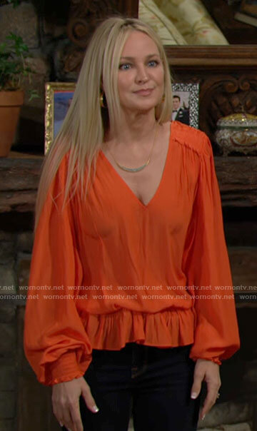 Sharon's orange v-neck ruffled blouse on The Young and the Restless