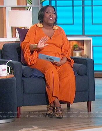 Sheryl's orange wrap jumpsuit on The Talk