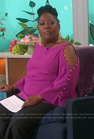 Sheryl's pink button sleeve top on The Talk