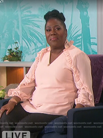 Sheryl's pink ruffle trim top on The Talk