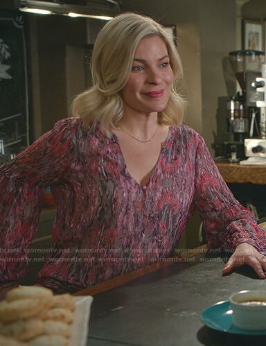 Stephanie's pink printed wrap top on Good Witch