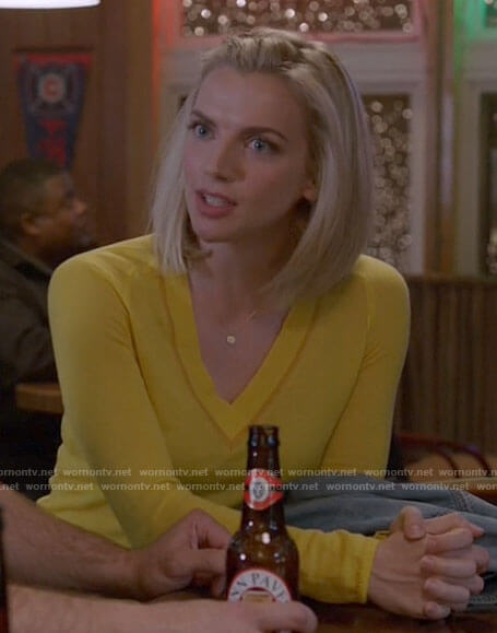 Sylvie's yellow v-neck sweater on Chicago Fire