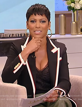 Tamron's black tipped blazer and leather pants on Tamron Hall Show