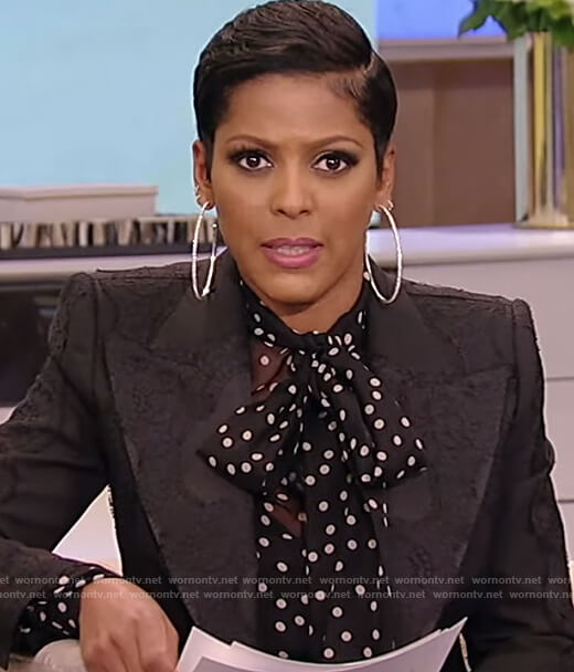 Tamron's black polka dot blouse and blazer on Tamron Hall Show