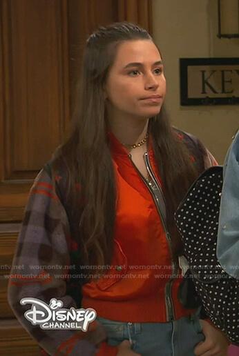 Tess's orange plaid-sleeve bomber jacket on Ravens Home