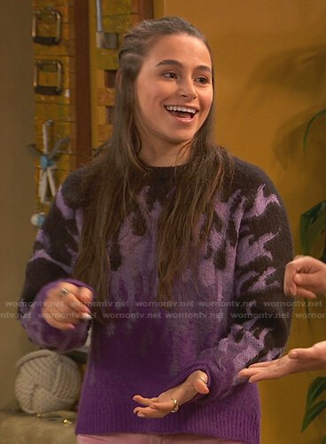 Tess's purple fire flame sweater on Ravens Home