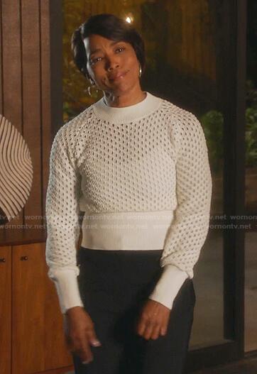 Athena's white open knit sweater on 9-1-1