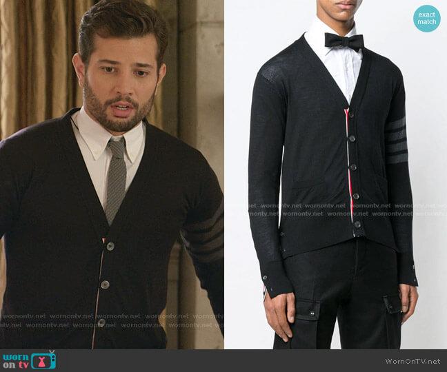 V-neck Cardigan by Thom Browne worn by Sam Flores (Rafael de la Fuente) on Dynasty