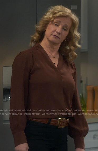 Vanessa's brown v-neck blouse on Last Man Standing