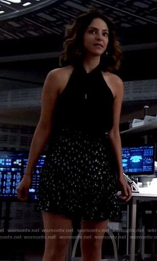 Zari's black tie neck top and metallic skirt on Legends of Tomorrow