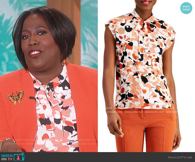 Printed Tie-Neck Top by Bar III worn by Sheryl Underwood  on The Talk