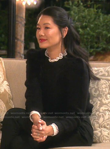 Crystal's white ruffle neck blouse and black sweater on The Real Housewives of Beverly Hills