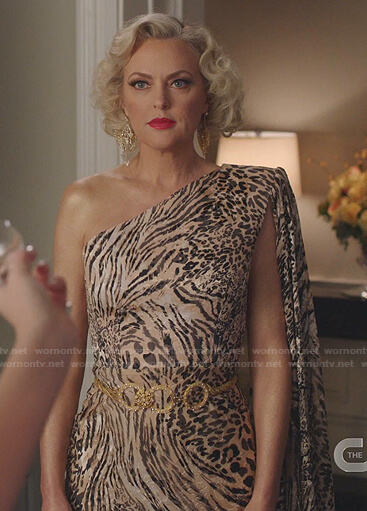 Alexis's black lace-up top and skirt with gold buttons on Dynasty