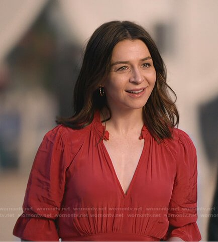 Amelia's red printed blouse and black coat on Greys Anatomy