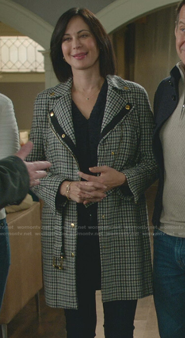 Stephanie's pink floral sweater and grey trench coat on Good Witch