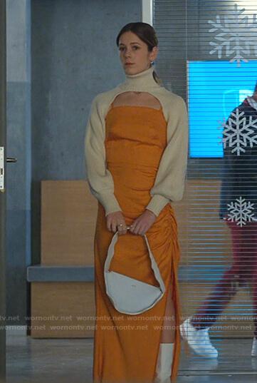 Cayetana's orange ruched dress and cream turtleneck cropped sweater on Elite