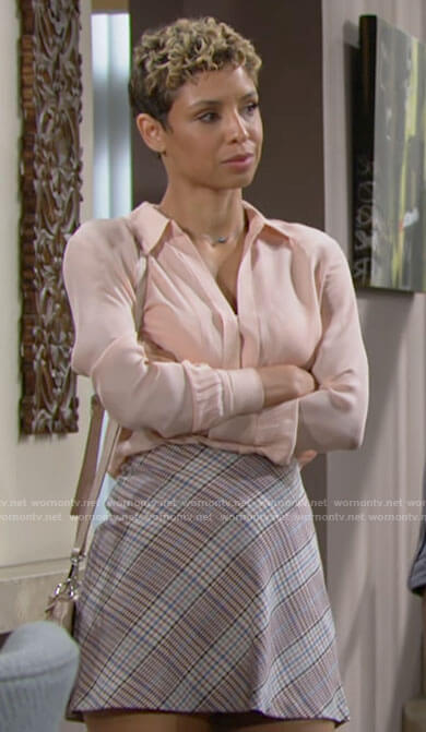 Elena's coral blouse and plaid skirt on The Young and the Restless