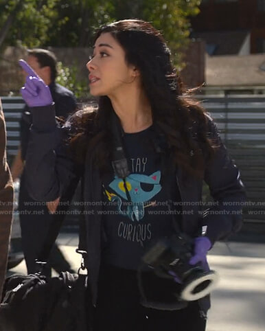 Ella's navy Stay Curious cat print tee on Lucifer