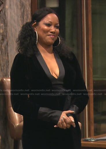 Garcelle's black velvet plunge neck jumpsuit on The Real Housewives of Beverly Hills