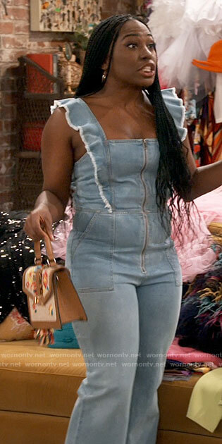 Harper's ruffled denim jumpsuit and floral bag on iCarly