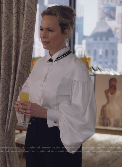 Jacqueline's white puff sleeve blouse and necklace on The Bold Type