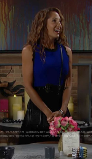 Lily's blue and black scalloped trim dress on The Young and the Restless