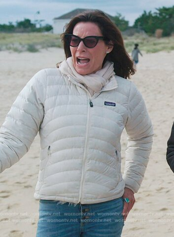 Eboni's brown puffer jacket and sunglasses on The Real Housewives of New York City