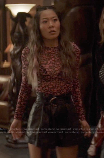 Mary's pink floral top and leather shorts on Batwoman