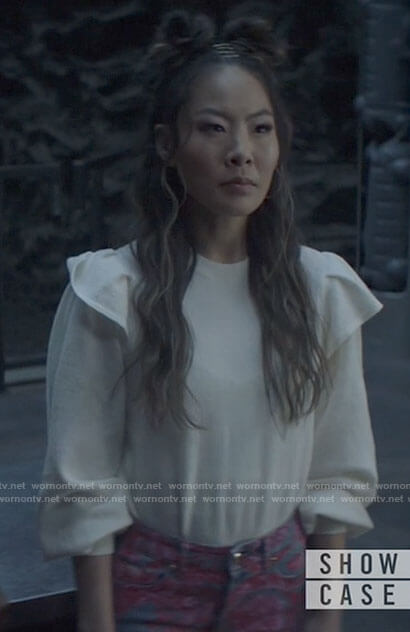 Mary's white ruffled shoulder sweater on Batwoman