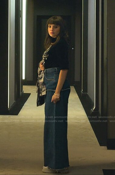 Mencia's black safety pin top and wide-leg jeans on Elite