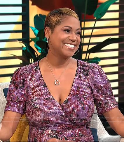 Monique Kelley's sequin wrap mini dress on E! News Daily Pop