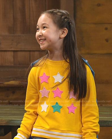 Nadine's yellow star patch sweatshirt on Bunkd