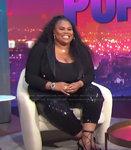 Nina's black sequin pants on E! News Nightly Pop