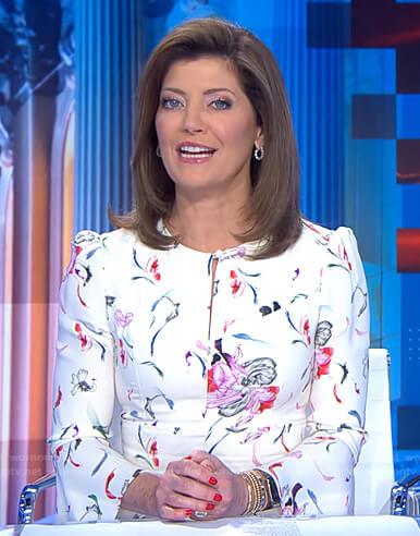 Norah's white floral keyhole dress on CBS Evening News