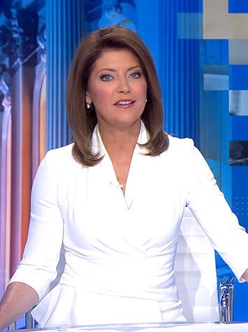 Norah's white peplum wrap top on CBS Evening News