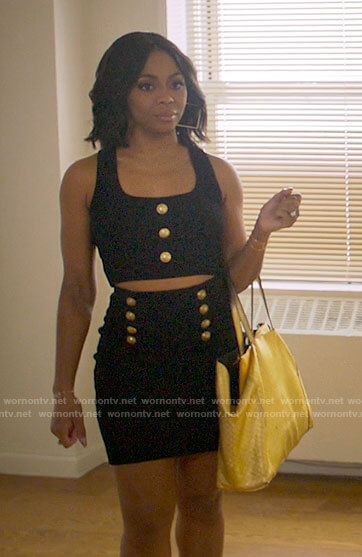 Renee's black crop top and skirt with gold buttons on Run the World