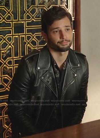 Sam's black distressed leather moto jacket on Dynasty