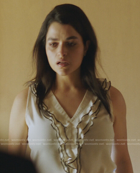 Samara's white ruffled top on Queen of the South