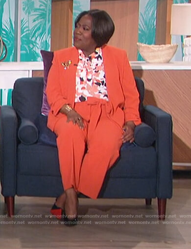 Sheryl's floral tie neck blouse and blazer on The Talk