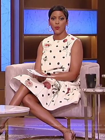 Tamron's white sleeveless floral dress on Tamron Hall Show