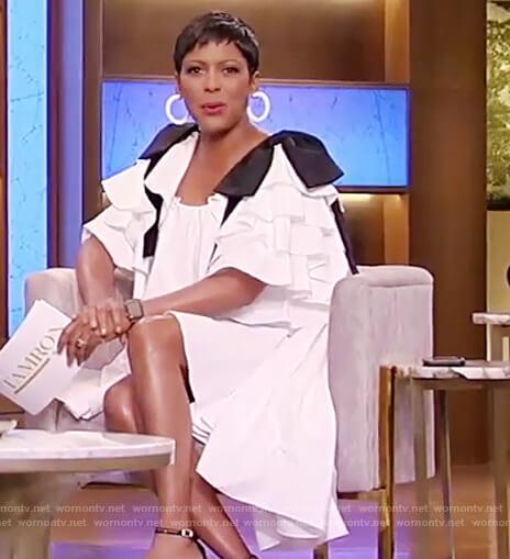 Tamron's white contrast tie sleeve dress on Tamron Hall Show
