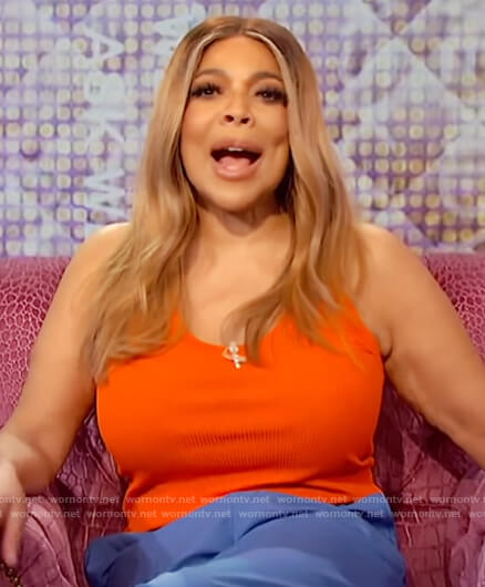 Wendy's orange tank and blue pants on The Wendy Williams Show