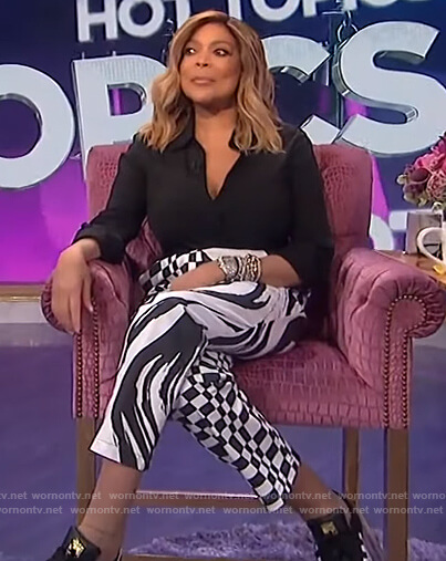 Wendy's black wrap blouse and printed pants on The Wendy Williams Show