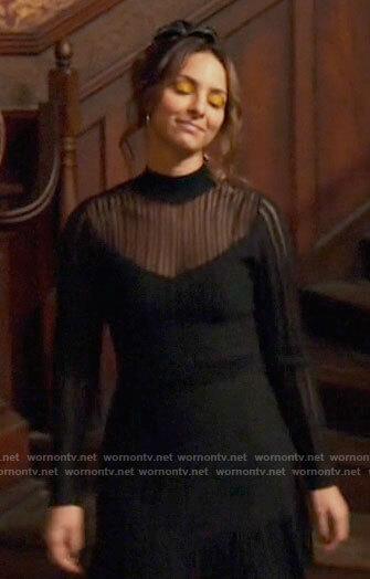 Zari's black mesh striped dress on Legends of Tomorrow