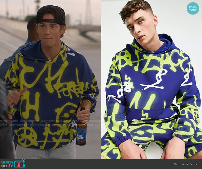 ASOS DESIGN coordinating oversized hoodie with all-over graffiti print worn by Zinn ( Nico Greetham) on American Horror Stories