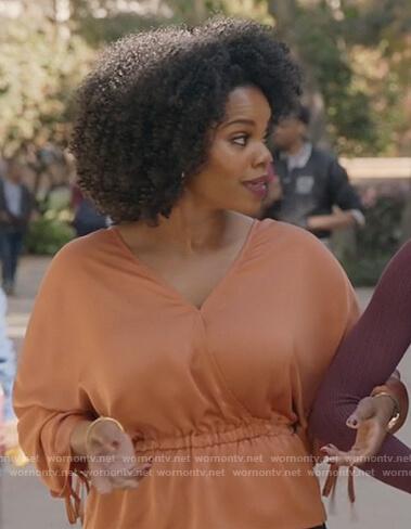 Amara's orange tie sleeve top on All American