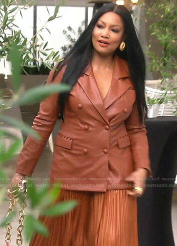 Garcelle's brown leather blazer and pleated skirt on The Real Housewives of Beverly Hills
