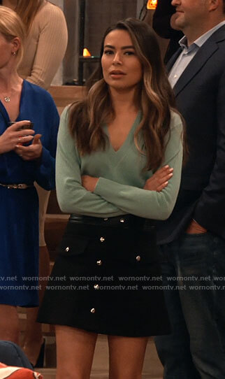 Carly's green pointelle v-neck sweater and black button front skirt on iCarly