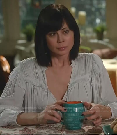 Stephanie's blue floral sweater on Good Witch