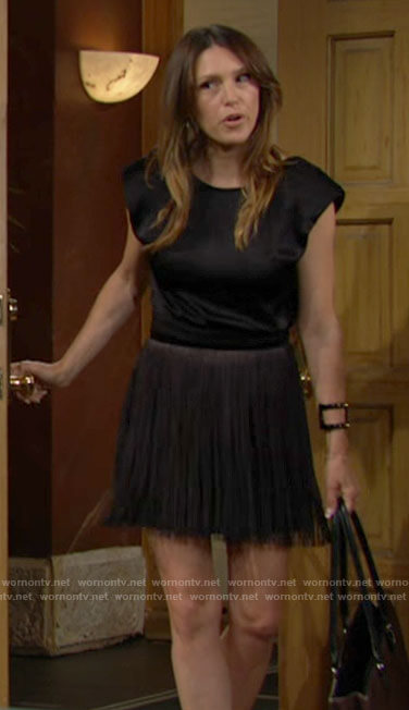 Chloe's black padded shoulder top and fringe skirt on The Young and the Restless